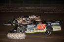 Garrett Alberson (59) and Ryan Unzicker (24) battle for the lead at Sycamore Speedway in Maple Park, Ill., on Saturday, Sept. 19, 2020. Alberson led the final three laps for a $10,000 victory. (Dan Simpson)