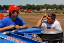 Darren Miller (left) and Steve Kosiski visit in the Boone County Speedway pits in Albion, Neb., before WDRL competition on July 23, 2006. (Jerry Jacobs)