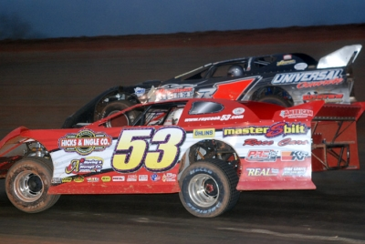 Ray Cook (53) moves past Ronnie Johnson (5). (DirtonDirt.com)