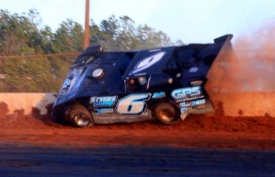 Jonathan Davenport wrecked after taking the checkers. (Clifford Dove)
