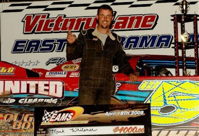 Mark Whitener enjoys victory lane at EAMS. (Rick Anges)