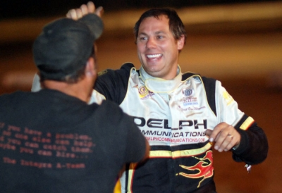 Crew chief Joe Drake congratulates Jeep Van Wormer. (DirtonDirt.com)