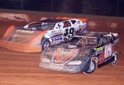 Johnny Pursley (09) battles Jonathan Davenport (49). (Randy Houser)