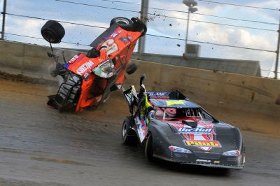 Chris Wilson (5) flips after a tangle with Vic Hill (1) in a heat race. (thesportswire.net)
