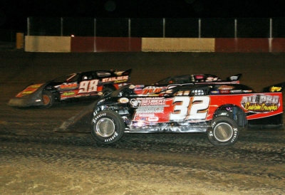 Jason Rauen (98) fights off Terry Anvelink (32) and others at Dubuque. (Paul Misner)