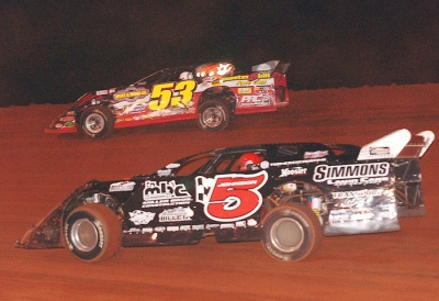 Ray Cook (53) holds off Ronnie Johnson (5) at TST. (Brian McLeod)