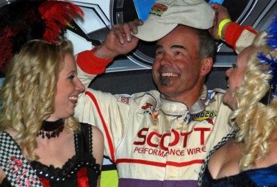 Billy Moyer puts on a cap in victory lane. (DirtonDirt.com)