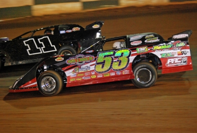 Ray Cook (53) puts a lap on Ryan Law (11) at Green Valley. (DirtonDirt.com)