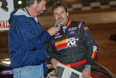 Ray Cook talks with announcer Rick Eshelman in victory lane. (DirtonDirt.com)