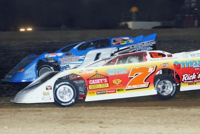 Mark Burgtorf (7) battles Jason Frankel (0) at Quincy. (Barry Johnson)