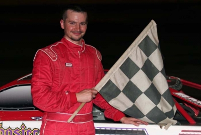 Casey Noonan picks up $2,000 and the checkers. (Steve Datema)