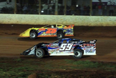 Donnie Moran (99) regains the lead from Shane Clanton (25). (Barry Lenhart)