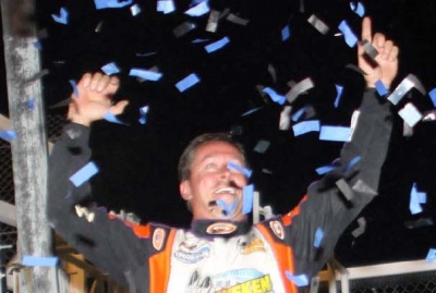 Rick Eckert celebrates in victory lane. (Jim DenHamer)