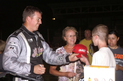 Winner Chad Simpson signs an autograph. (Dana Royer)
