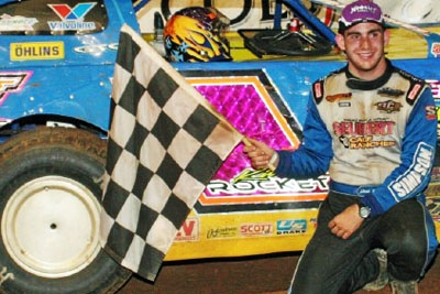 Josh Richards celebrates after a World of Outlaws victory at Columbus (Miss.) Speedway in 2006. (Tim Henry)