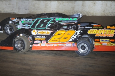 Eddie Carrier Jr. (28) works on Eric Wells (18) at Florence. (Jeremey Rhoades)