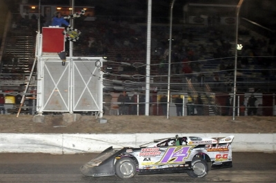 Brad Looney takes the checkers in Greenwood, Neb. (fasttrackphotos.net)