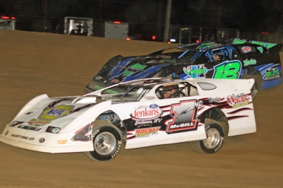 Butch McGill (1mc) holds off Robbie Scott (18) at Elkins Raceway. (Tommy Michaels)