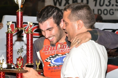Dustin Linville enjoys victory lane at Mountain Motor Speedway. (photobyconnie.com)