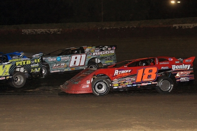 Shannon Babb (18) moved by Scott James (81)in traffic to win at Peoria. (stlracingphotos.com)
