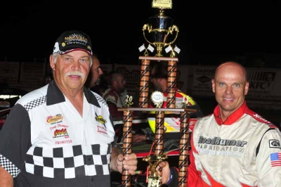 Track promoter Doug Stange joins Kelly Boen in victory lane at Mid-Nebraska Speedway. (Jerry Jacobs)