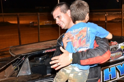 Josh Putnam is welcomed to victory lane with a hug. (photobyconnie.com)