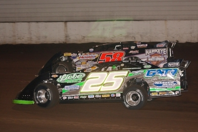 Winner Chad Simpson (25) works under leader Dave Eckrich (58) at Highway 3 Raceway. (K.C. Rooney)