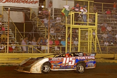 Brandon Smith takes the checkers at 67 Speedway. (Woody Hampton)