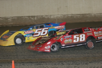 Andy Eckrich (56) and Ray Guss Jr. (58) battle on the final lap. (Barry Johnson)