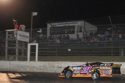 Billy Moyer Jr. takes the checkers at Topeka for the second straight night. (fasttrackphotos.net)
