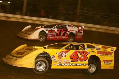 Jared Hawkins (37) takes the lead from Jason Covert (43a) in the final laps. (Tommy Michaels)