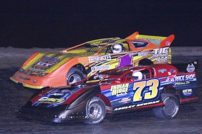 Winner Ashley Newman (73) goes by Johnny Stokes (1) at Greenville. (Best Photography)