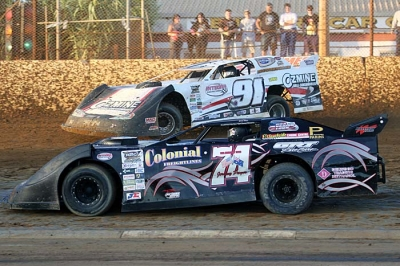 Jeremy Payne (74) races under Steve Francis at Bunbury Speedway. (Jody Shanhun)