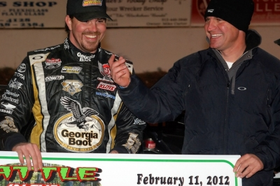 Jonathan Davenport (left) and car owner Clint Bowyer enjoy victory lane. (DirtonDirt.com)