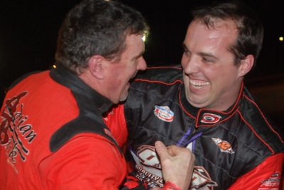 Runner-up David Turner (left) gives winner Jesse Stovall a hard time in victory lane. (DirtonDirt.com)