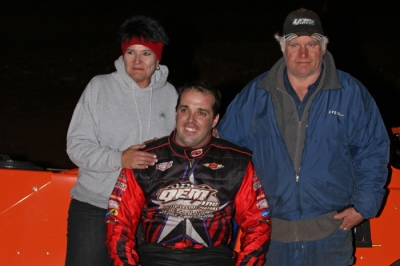 Jesse Stovall with car owners Lori and Al Humphrey (erikgrigsbyphotos.com)