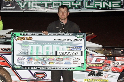 Brad Looney shows off his $3,000 winner's check at Springfield. (Ron Mitchell)
