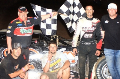 Shane Hebert (second from right) and teammates celebrates his victory in his Late Model debut. (Best Photography)