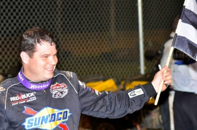 Brad Neat enjoys victory lane at North Alabama. (photobyconnie.com)