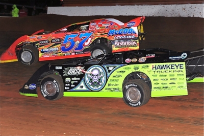 Runner-up Scott Bloomquist (0) looks under winner Bub McCool at Tazewell. (dt52photos.com)
