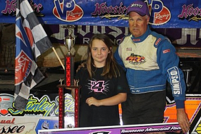 Haley Brooks, who has a rare form of cancer, posed with Skip Arp in victory lane. (Ronnie Barnett)