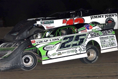 Kevin Weaver (12) and Jason Feger (25) battle for the lead at Kankakee. (Jim DenHamer)