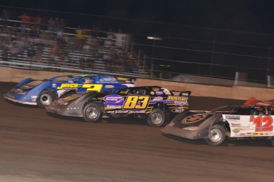 Brian Shirley (3) inches ahead of Scott Bull (83) at Fairbury. (Rocky Ragusa)
