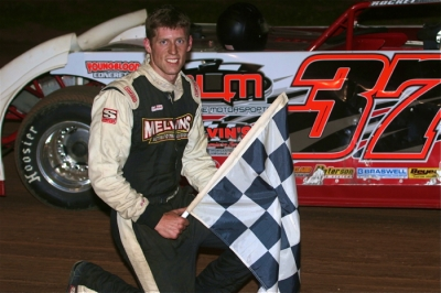 Jared Hawkins celebrates his $3,000 victory. (Todd Battin)