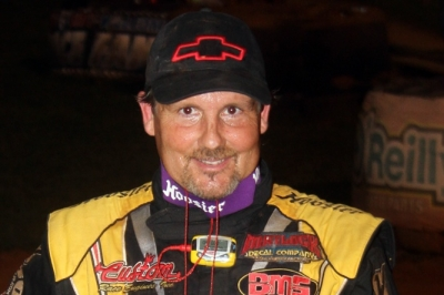 Billy Ogle Jr. smiles in victory lane at 411 Motor Speedway. (Chad Wells)