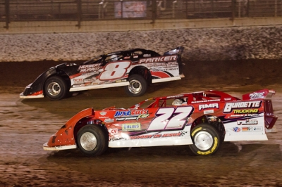 Chris Ferguson (22) stalks Ron Parker at the Dirt Track at Charlotte. (Gary Laster)