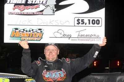 Nick Dickson shows off his earnings Sunday at Hesston (Pa.) Speedway. (pbase.com/cyberslash)