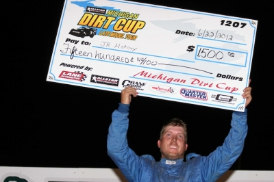 J.R. Hotovy holds up the winner's paycheck. (Steve Datema)