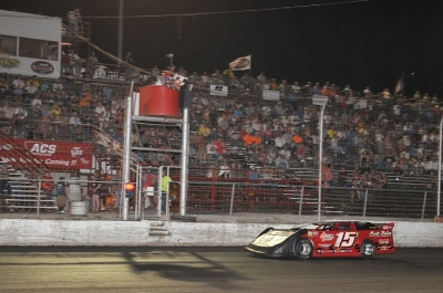 Jesse Stovall takes the checkers at Adams County in David Turner's car. (fasttrackphotos.net)