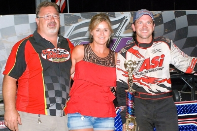 Brian Birkhofer celebrates with Bill and Josie Schlieper of Pro Power Engines. (Rocky Ragusa)